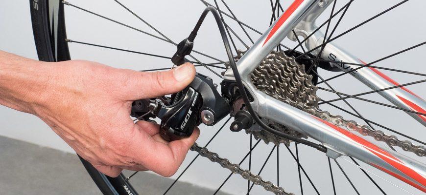 Как отрегулировать заднее колесо на велосипеде